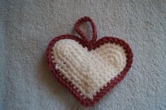 White crochet heart ornament with mauve trim by CreativeCrochetbyChris, $5.00 USD SOLD