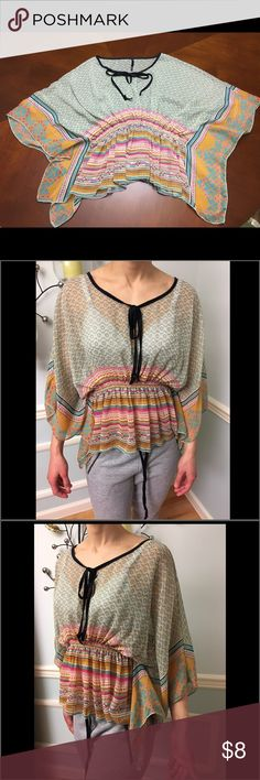 "💗Love Culture sheer top💕 💗Love Culture sheer top💕 with black ties at neckline, elastic ruching above waistline. Colors in top: turquoise, orange, cream, pink, black, and hints of brown.🎀 Tag removed from inside of left sleeve. I believe it is a small top. Model is 5'4"", waist 27"", bust 32B. Love Culture Tops Blouses"