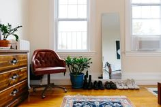 "Elijah describes the (super cool) style in his 450(ish) square foot Somerville apartment as ""Ralph Lauren's son returns from study abroad in Stockholm."""