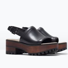 Clogs, love or loathe them, are hot for summer 2015. Zara's wooden platform take the aesthetic and make them look a whole lot better. | £49.99