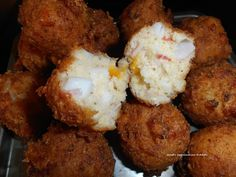 Bubba Gump's Seafood Hush Pups (from Janet's Appalachian Kitchen)... 6 oz. can drained White Crab Meat, 1 c. Cornmeal, 1/2 c. Self-Rising Flour, 1/4 c. fine-chopped Onion, 1 c. chopped Krab Imitation Crab Meat, 1/2 c. finely-diced Sharp Cheddar, 1 tsp. Old Bay Seasoning, 1 large beaten Egg, 1/4-1/2 c. Milk, Vegetable Oil...