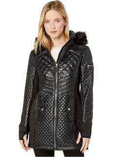 Women's Black Quilted Puffer Jacket With Hood by Michael Kors. Black Quilted Nylon Hooded Puffer Parka Jacket Women's. The quilted nylon puffer jacket features a removable hoodie with a faux-fur trim for versatile wear. #PufferCoats #WinterCoats #MichaelKors