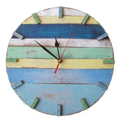 Skilled artisans take wood reclaimed from old buildings and boats to make our charming Sky Reclaimed Wood Wall Clock.  Reclaimed wood gives each of these pieces a unique quality, so no two are exactly alike. Evoking days at the beach with shades of yellow, creamy white and ocean blues, each one-of-a-kind piece will bring a pop of welcome color and sustainable design to any room.  This clock runs on batteries, so you can hang it on any wall, or you could even lean it on a shelf.