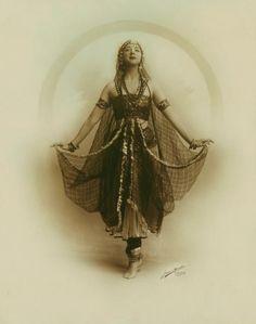 Gorgeous costume, veil worn as a skirt. 1/2
