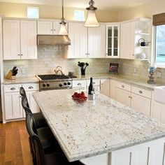 Cream Granite with subway tile backsplash// ...oh how I'd luv to have this kitchen, that Island!! perfection! Clear big working space!