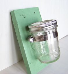 Our green Mason jar wall planter / hanger / sconce / caddy / organizer is made of reclaimed shipping crate or recycled pallet wood a new Mason