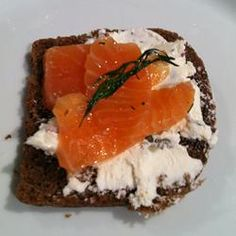 Gravlox Allrecipes.com  I use skinned salmon filets and use juniper berries instead of gin.  I also use more salt and white sugar instead of brown.  I drain off the liquid each time I turn it.  It really takes 72 hrs. to be at its best.  Serve with Swedish mustard.