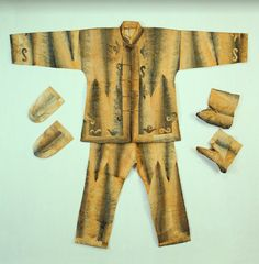 Men's Salmon Skin Robe with Applique This is a salmon skin suit, the traditional garb of Hezhe (Nanai) men. Making clothing from fish skins is a tradition unique to the Hezhe. A suit consists of a. Amur River, Alaska, Skins Clothing, Salmon Skin, Native American Design, First Nations, Man, Trousers, Fish