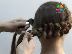 A head-hugging dutch braid. I think it's in Russian, but either way it shows a really useful technique: puffing out the braid as you braid it.