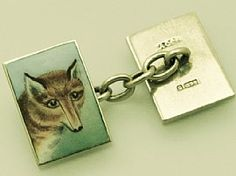 A fine pair of antique enamel and 9 carat yellow gold cufflinks depicting a fox's head