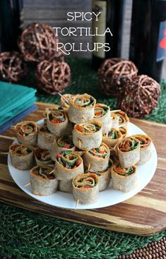 Spicy Tortilla Rollups are layers of flavor starting with a spicy pesto base and ending with fresh baby spinach. Roll up tight, slice and pop in your mouth. #SeasonedGreetings #ad