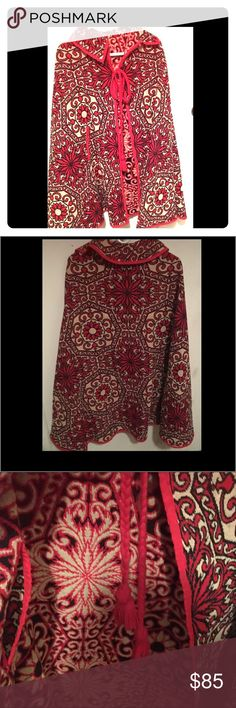 UNIQUE VINTAGE PAISLEY/FLORAL TAPESTRY CAPE! WOW This is a rare one-of-a-kind  and unique paisley/floral vintage cape! It is the red dark blue and tan in color! The inside and the outside are the same except the colors are inverted. This case is absolutely amazing! It is a quality made article of clothing! In wonderful conditionj! If you like vintage you must have this item! It really doesn't get more vintage than this! Jackets & Coats Capes