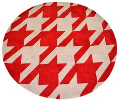 """A contemporary styled bespoke rug hand tufted with pure wool in scarlet red and soft mocha. It has a pile depth of 12-14mm. Created using the """"molar"""" design."""