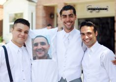 Groomsmen posing with pillow of grooms head that bride keeps with her. Funny group groomsmen photo. Groom's face printed onto a pillow.
