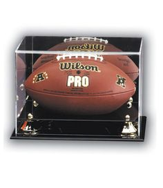 The Deluxe Football Acrylic Display Case is the perfect choice for protecting your collectable. This elegant ball display case features a mirrored back and a black acrylic base el Football Trophies, Acrylic Display Case, Black Acrylics, Team Logo