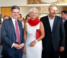 French Ambassador Francois Delattre, International Monetary Fund managing director Christine Lagarde, and Xavier Giocanti at the French Embassy's Bastille Day celebration. Photo: French Embassy via Bloomberg