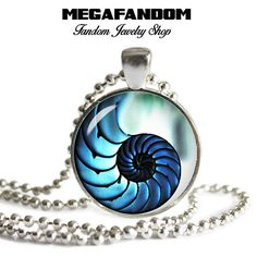 """Fibonacci Spiral Photo Glass Necklace 1"""" round Pendant with a beautiful high resolution printed image sealed under a high quality glass dome. Silver plated pendant tray. Come with a silver plated ball"""