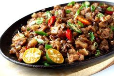 "Sisig was recently named as the ""greatest pork dish"" in the world. Learn how to cook this delicious and easy to prepare Filipino recipe."