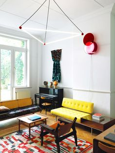 Modern living room with architectural lighting and yellow sofa