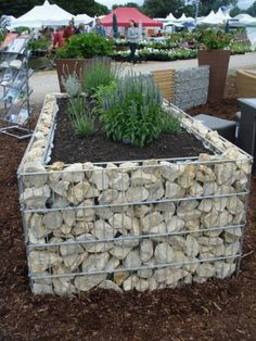 10 Awesome DIY Raised Garden Bed Designs You Should Try For Your Home Rock Gabion Raised Bed Garden #gardening #raised_garden_beds #garden_designs