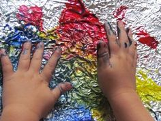 aluminum foil preschool art.  Have child paint and then place a paper on top and rub to get print.   Rinse foil and do again with another child.