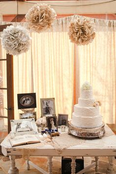 Cake table decorate with paper pom pom and photos