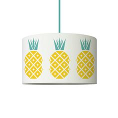 Add some tropical style your home with this on-trend vintage-inspired Disco Pineapple pattern lamp shade in glorious shades of yellow and aqua! The Disco Pineapple pattern fabric is designed by Suzie and is exclusive to Suzie London. Handmade in London from 100% cotton lawn fabric printed in the UK, with a fire-retardant PVC backing and ceiling and/or lamp base fitting. The pattern is directional, so please select either a ceiling light fitting or with a table/floor lamp fitting. Please…