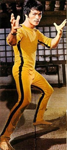 Game of Death - Bruce Lee as Billy Chen Lo wearing a custom-made yellow jumpsuit with black side stripes. He used custom-made yellow wooden nunchaku in the central fighting sequence. Both items are up...