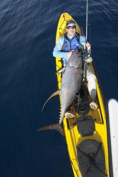 Jeffrey Pierce stamps his big-game kayak fishing ticket. Photo: Jordan Ellis