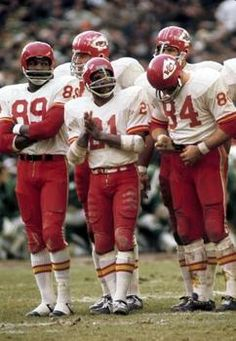 ; Kansas City Chiefs receiver Otis Taylor (89), running back Mike Garrett (21), and tight end Fred Arbanas