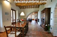 The dining room at luxury Villa Padrone, a holiday rental house on the Tuscany Umbria border near Tuoro on Lake Trasimeno. Discover more here http://www.tuscanyumbria.com/italian-villas/small-rentals/padrone/