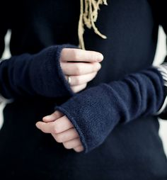 cute fingerless mittens made out of fingering weight yarn. I wouldn't wanna knit them using black yarn, though!