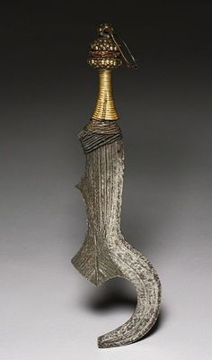 African Knife      Dated: circa 1900     Place of Origin: Central Africa, Democratic Republic of the Congo, Bangala     Medium: iron, wood, and brass