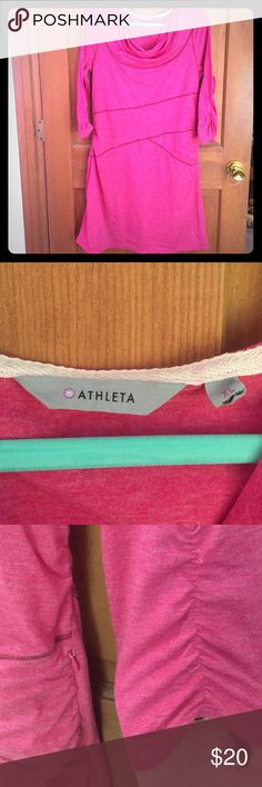 Athleta active wear dress! Super cute Athleta active wear dress! Size XL. Heathered pink with maroon seams. Relaxed neck line and cinched areas on the sides of the dress and on the 3/4 sleeves. Stretchy material; 4% spandex, 63% polyester, 33% rayon. Gently worn with some pilling, but not noticeable when actually wearing. Zipper on left side to put on with ease. Smoke free home! Athleta Dresses Long Sleeve