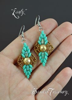"""Earrings from the """"Leafy"""" set, made with fire polished beads, 2-hole superduo and rulla beads and seed beads. Beading pattern by BeadedTreasury."""