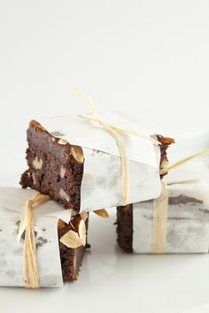 Tiny Fanciful Brownies  Individually wrapped and tied up with raffia,  these brownies could easily double as favors.  Created by Festivities Catering  Photography by Siegel Thurston Photography