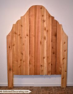Very tall wood headboard made from cedar fence pickets for $25