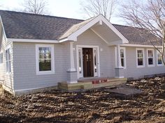 anderson windows (6 over 1), seacoast maibec gray, azek trim...looks close to the pewter gray roof from timberline