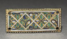 Plaque from a Reliquary Shrine, c. 1170 Germany, Rhine Valley, Cologne, Romanesque period, 12th century gilded copper; champlevé and cloisonné enamel, Overall - h:2.70 w:6.05 cm (h:1 1/16 w:2 3/8 inches). Gift of Rosamond Zverina 1957.502 Cleveland Museum of Art
