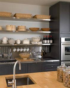 Open shelving in stainless steel for the kitchen. Love the bar with hooks to hang utensils.