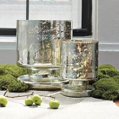 Mercury glass is popping up everywhere. Elegant and beautiful, the technique is easy to do and is an affordable way to dress up a variety of glass pieces. Use it on empty glass bottles, add it to vases and votives. Mercury Glass Mirror, Mercury Glass Candle Holders, Hurricane Candle Holders, X 23, Looking Glass Spray Paint, Empty Glass Bottles, Hurricane Vase, Vintage Bottles, Pottery Barn