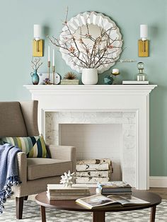 Living Room Color Scheme: Warm Blue Robin's Egg + White + Driftwood  While blue is technically a cool color, shades, like the wall color in this living room, that sport a little bit of yellow come off as warmer. In this space, the warmth is enhanced by a cozy gray chair and wood coffee table. The white fireplace and mirror are brighter counterpoints to the warm hues. Accessories in shades similar to the wall color tie the space together.
