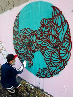 Aqua street art. I find this fascinating because you don't expect a young guy to create a pretty pattern like this.