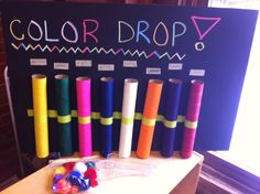 Children put the colored pompom with tongs into the matching colored tube.