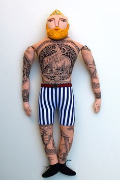 Blonde tattoo man doll.  Toile fabric for his chest (and I'm so amused that he has little embroidered nipples.)