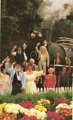 Dolly Parton ...~@ Dollywood This is an old photo of Dolly and park employees taken at oldest ride at the park,  the Dollywood Express
