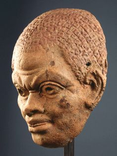 Roman  Mask of a male African, 3rd century A.D.  Terracotta