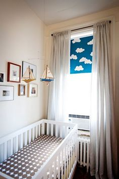 Great idea for nursery: blackout shades with floor length 'sheerish' curtains. Blackout shade for naptime/sleeping and sheers for playtime during the day. Definitely doing this.