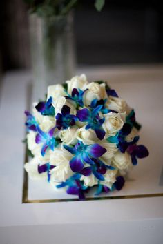 White rose bouquet, with blue singapore orchids #weddings  www.RedEarthFlowers.com.au