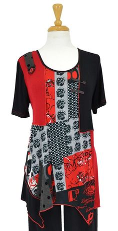 Black coral red tunic with panels and flower pattern in grey- Very stylish abstract print- Fully lined tunic- Frilled small sleeves- Polyester + viscose mix stretch fabric - gives a great fit- Uneven hem look